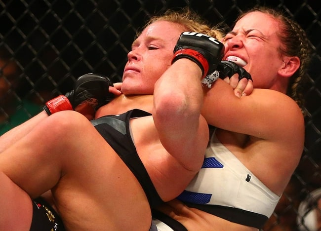 March 5, 2016; Las Vegas, NV, USA; Miesha Tate applies a chokehold to win by submission against Holly Holm during UFC 196 at MGM Grand Garden Arena. Mandatory Credit: Mark J. Rebilas-USA TODAY Sports
