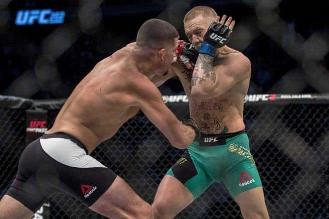 Aug 20, 2016; Las Vegas, NV, USA; Nate Diaz (red gloves) competes against Conor McGregor (blue gloves) during UFC 202 at T-Mobile Arena. Mandatory Credit: Joshua Dahl-USA TODAY Sports