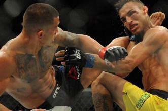 Aug 27, 2016; Vancouver, BC, Canada; Anthony Pettis (red gloves) competes against Charles Oliveria (blue gloves) during UFC Fight Night at Rogers Arena. Mandatory Credit: Anne-Marie Sorvin-USA TODAY Sports