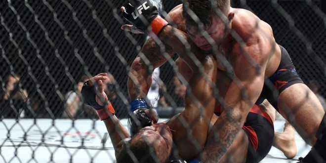 Oct 8, 2016; Manchester, UK; Danny Roberts (red gloves) fights against Mike Perry (blue gloves) during UFC 204 at Manchester Arena. Mandatory Credit: Per Haljestam-USA TODAY Sports