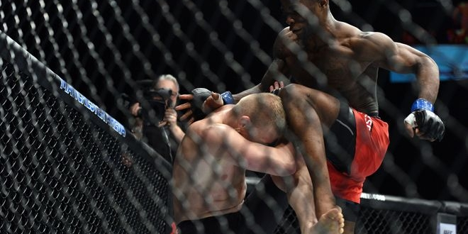 Oct 8, 2016; Manchester, UK; Lukasz Sajewski (red gloves) fights against Marc Diakiese (blue gloves) during UFC 204 at Manchester Arena. Mandatory Credit: Per Haljestam-USA TODAY Sports