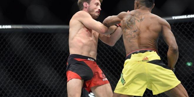 Oct 8, 2016; Manchester, UK; Brad Pickett (red gloves) fights against Iuri Alcantara (blue gloves) during UFC 204 at Manchester Arena. Mandatory Credit: Per Haljestam-USA TODAY Sports