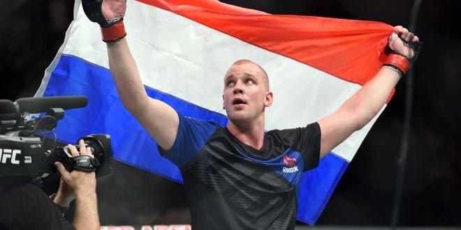Oct 8, 2016; Manchester, UK; Stefan Struve (red gloves) celebrates his win against Daniel Omielanczuk (blue gloves) during UFC 204 at Manchester Arena. Mandatory Credit: Per Haljestam-USA TODAY Sports