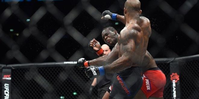 Oct 8, 2016; Manchester, UK; Ovince Saint Preux (red gloves) fights against Jimi Manuwa (blue gloves) during UFC 204 at Manchester Arena. Mandatory Credit: Per Haljestam-USA TODAY Sports