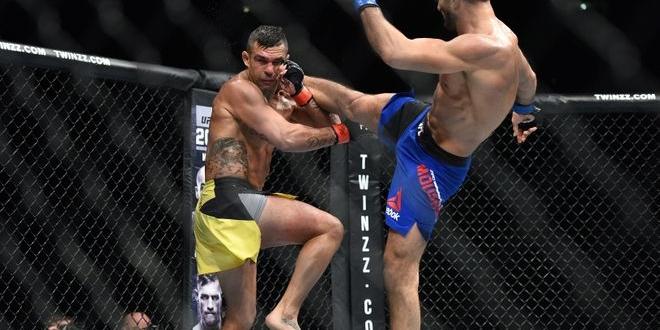 Oct 8, 2016; Manchester, UK; Vitor Belfort (red gloves) fights against Gegard Mousasi (blue gloves) during UFC 204 at Manchester Arena. Mandatory Credit: Per Haljestam-USA TODAY Sports