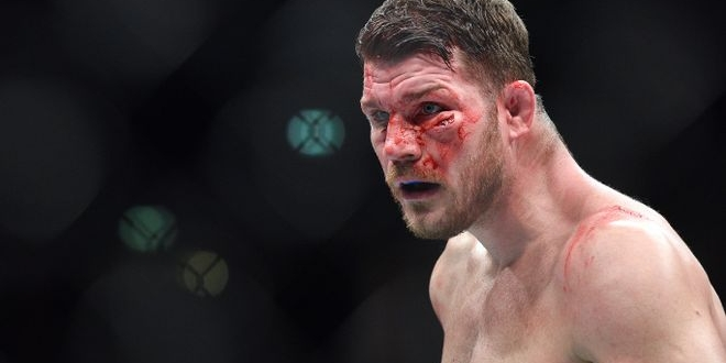 Oct 8, 2016; Manchester, UK; Michael Bisping (red gloves) bleeds from a cut during his fight against Dan Henderson (blue gloves) in the UFC 204 at Manchester Arena. Mandatory Credit: Per Haljestam-USA TODAY Sports