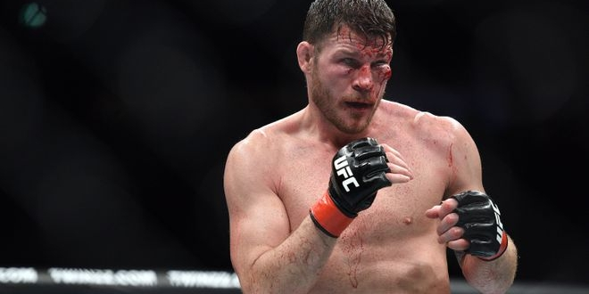 Oct 8, 2016; Manchester, UK; Michael Bisping (red gloves) cut under his left eye during his fight against Dan Henderson (blue gloves) in the UFC 204 at Manchester Arena. Mandatory Credit: Per Haljestam-USA TODAY Sports