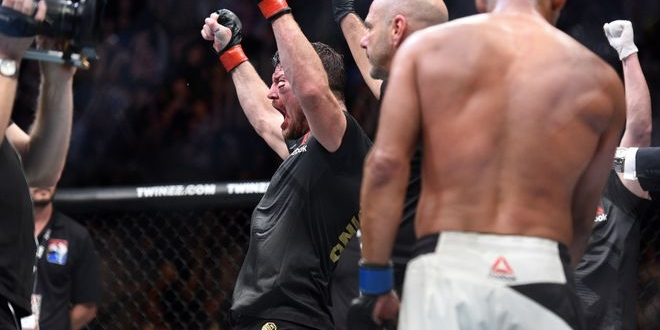 Oct 8, 2016; Manchester, UK; Michael Bisping (red gloves) reacts after winning his fight against Dan Henderson (blue gloves) during UFC 204 at Manchester Arena. Mandatory Credit: Per Haljestam-USA TODAY Sports