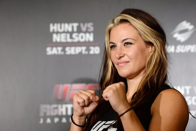 TOKYO, JAPAN - AUGUST 26:  Miesha Tate, UFC women's bantaweight poses for a photograph during a UFC press conference at Akasaka Garden City on August 26, 2014 in Tokyo, Japan.  (Photo by Atsushi Tomura/Getty Images)