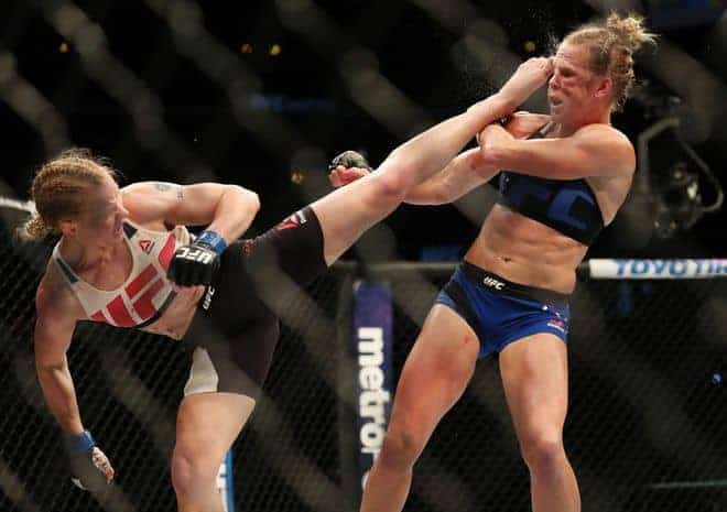 July 23, 2016; Chicago, IL, USA; Holly Holm (red gloves) cis kicked by Valentina Shevchenko (blue gloves) in their women's bantamweight bout during UFC Fight Night at United Center. Mandatory Credit: Kamil Krzaczynski-USA TODAY Sports