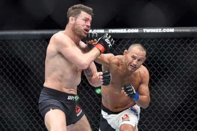 Oct 8, 2016; Manchester, UK; Michael Bisping (red gloves) fights against Dan Henderson (blue gloves) during UFC 204 at Manchester Arena. Mandatory Credit: Per Haljestam-USA TODAY Sports